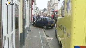Editie NL Man ramt gevel bordeel