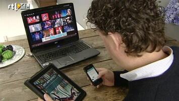 Editie NL Tv kijken met het scherm op schoot