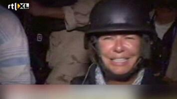 RTL Nieuws Journalist tussen feestende Libiërs