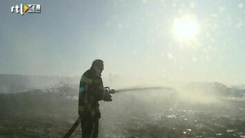RTL Nieuws Met man en macht tegen Schoorlse brand