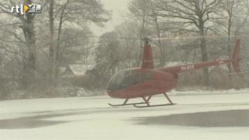 RTL Nieuws Heli blaast sneeuw van ijsbaan