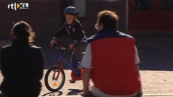 Editie NL 'Kind verplicht aan de fietshelm'